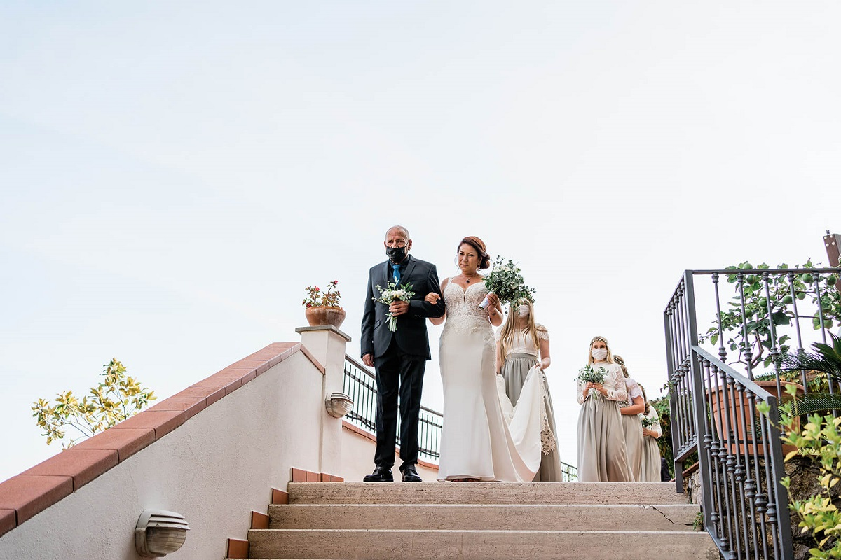 bridesmaids with masks wedding in Italy during the covid emergency